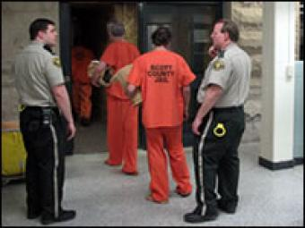 Inmates being let into the jail by correction officers.