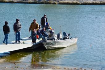 photo of people on a boat at the fishing dock
