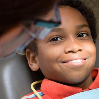 Child receiving dental screening