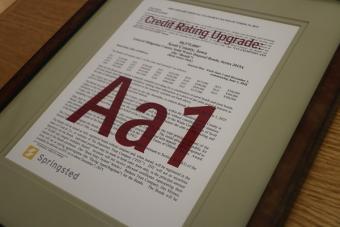 Credit rating upgrade award.