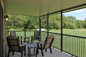 The covered patio featuring patio furniture for four people.