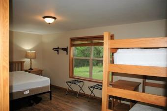 Bedroom with queen size bed and bunk bed.