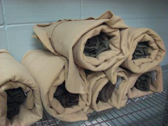 Rolled jail bed sheets.
