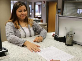 Recorder's Office staff assisting customer at the counter.
