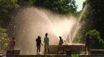 Children playing in Outdoor Fountain at Vander Veer Park