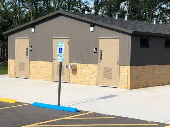 Front view of the Woodside Campground restroom / shower house.
