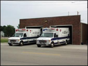 Two ambulances in their garage bays.