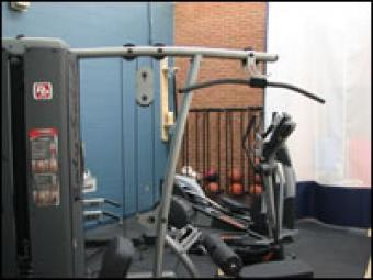 A stationary weight set and workout equipment.