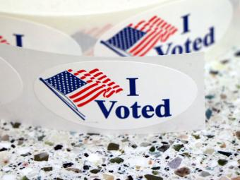 """Sticker that reads """"I Voted"""" with an American Flag."""