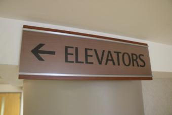 Sign with arrow to Elevators.