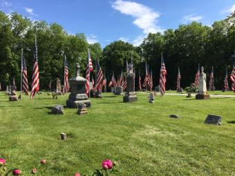 U.S. Flags adorn Allens Grove Cemetery, Scott County.