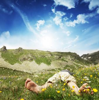 Photo of a Man Relaxing in the Mountains