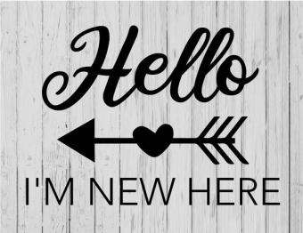 """Hello, I'm New Here"" written in black on wood sign."