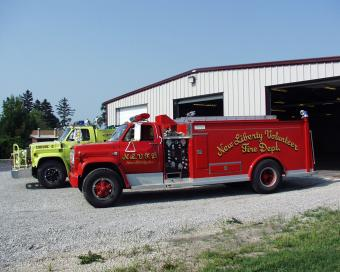New Liberty engine 1 and 2 with station in background.