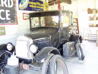 An antique automobile in the repair garage.