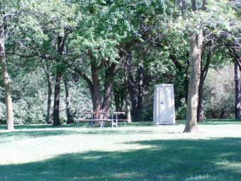 Picnic table under the trees.