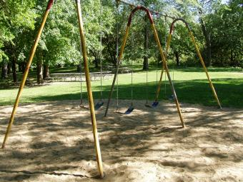 Swings located near the shelter.