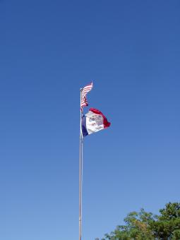 The U.S. and Iowa flags flying at the shelter.