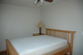 A bedroom at Summit Cabin with a queen bed. ADA Accessible.