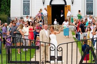 Wedding group gathered outside of church.