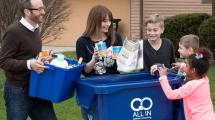 Neighborhood comes together to recycle around new cart.