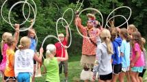 Campers playing with hula-hoops during an indian presentation.