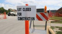 """Construction sign that reads """"Lot Closed for Construction."""""""
