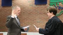Swearing in Treasurer Mike Fennelly.