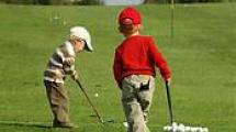 phot of two children putting